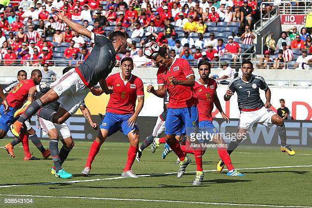 Celso Borges of Costa Rica heads the ball during the 2016 Copa America Centenario Group A match between Costa Rica and Paraguay at Camping World...