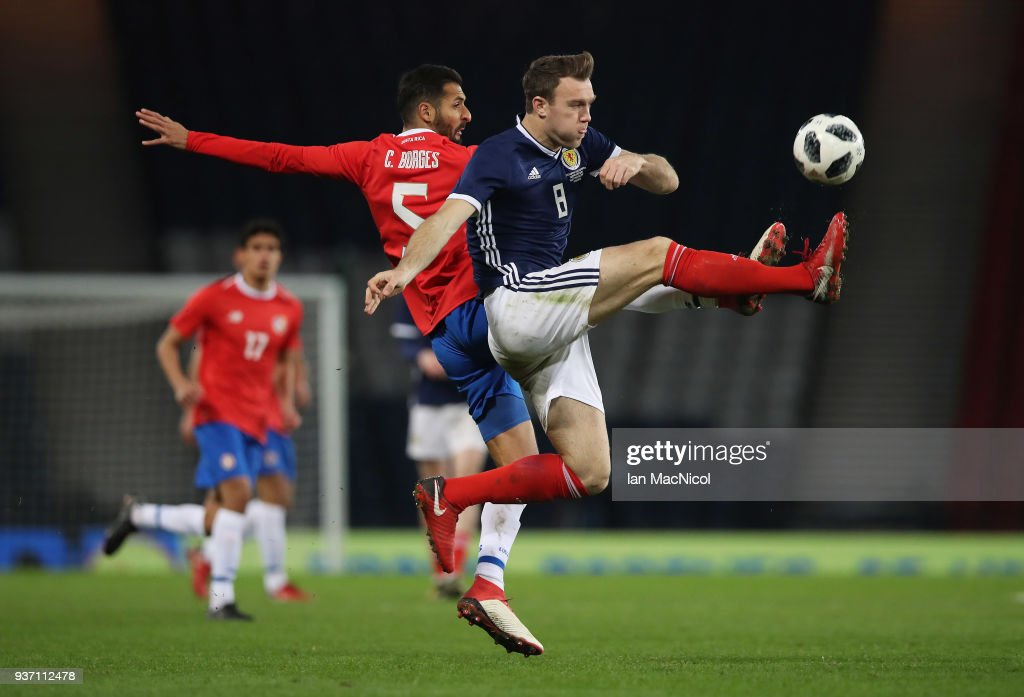 Celso Borges of Costa Rica vies with Kevin McDonald of Scotland during the Vauxhall International Challenge match between Scotland and Costa Rica at Hampden Park on March 23, 2018 in Glasgow, Scotland.