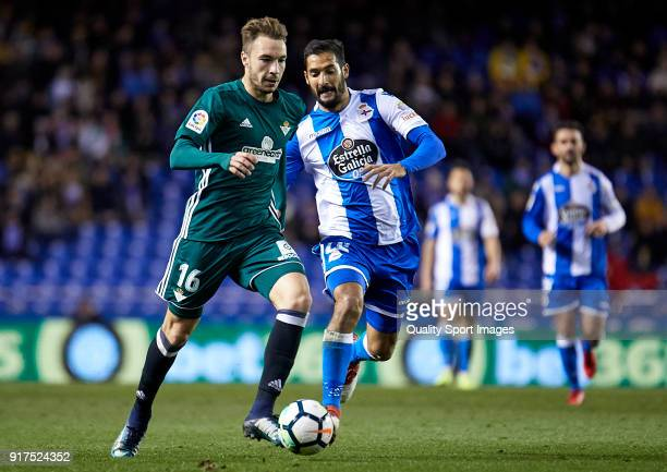 Celso Borges of Deportivo de La Coruna competes for the ball with Loren of Real Betis during the La Liga match between Deportivo La Coruna and Real...