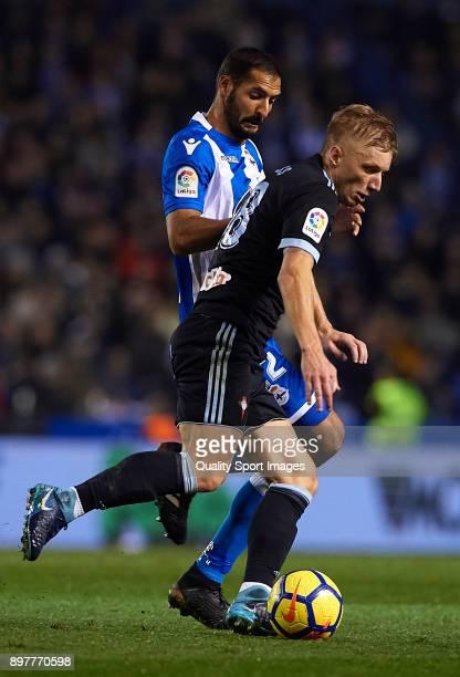 Celso Borges of Deportivo de La Coruna competes for the ball with Daniel Wass of Celta de Vigo during the La Liga match between Deportivo de La...