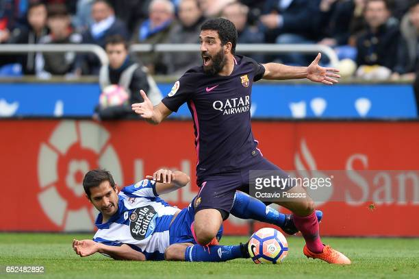 Celso Borges of RC Deportivo La Coruna competes for the ball with Arda Turan of FC Barcelona during the La Liga match between RC Deportivo La Coruna...