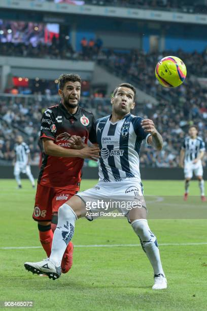 Celso Ortiz of Monterrey fights for the ball with Jose Rivero of Tijuana during the third round match between Monterrey and Tijuana as part of Torneo...