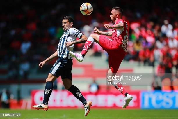 Celso Ortiz of Monterrey struggles for the ball with Federico Mancuello of Toluca during the 13th round match between Toluca and Monterrey as part of...