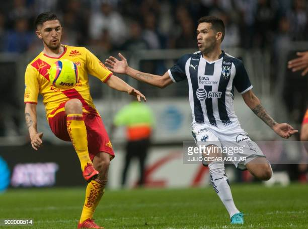 Celso Ortiz of Monterrey vies for the ball with Diego Valdes of Morelia during the Mexican Clausura 2018 tournament football match at the BBVA...