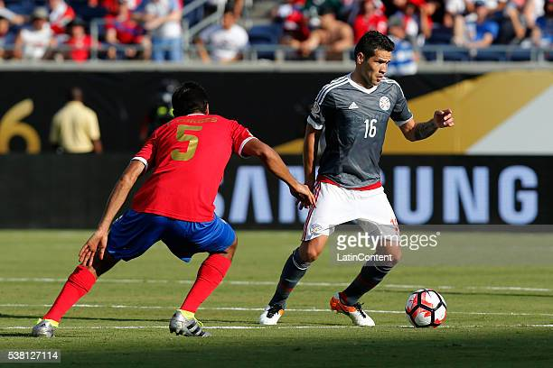Celso Ortiz of Paraguay passes against Celso Borges of Costa Rica during a group A match between Costa Rica and Paraguay at Camping World Stadium l...