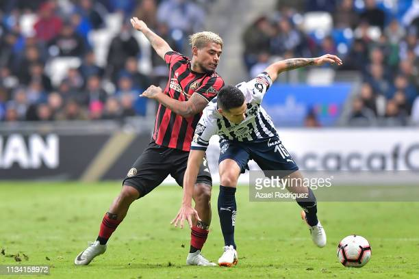 Celso Ortíz of Monterrey fights for the ball with Josef Martinez of Atlanta United during the quarterfinals first leg match between Monterrey and...