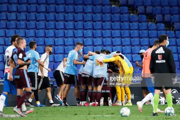 Celta de Vigo players celebrate at the end of the Liga match between RCD Espanyol and RC Celta de Vigo at RCDE Stadium on July 19, 2020 in Barcelona,...