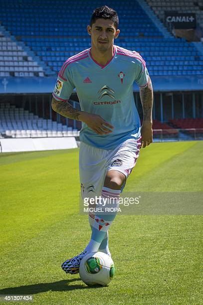 Celta de Vigo's new Chilean player Pablo Hernandez poses during his presentation at the Balaidos stadium in Vigo on June 26 2014 AFP PHOTO / MIGUEL...
