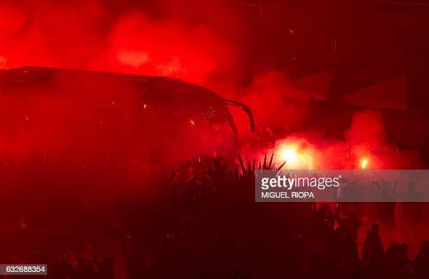 Celta de Vigo's supporters brandish scarves and light flares upon the arrival of their team's bus at the Balaidos stadium prior to the Spanish Copa...