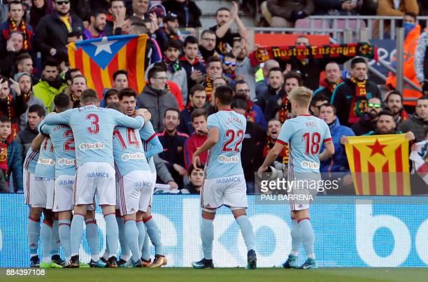 Celta players celebrate the opening goal during the Spanish league football match FC Barcelona vs RC Celta de Vigo at the Camp Nou stadium in...