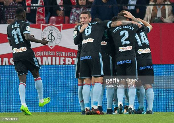 Celta Vigo players celebrate a goal during the Spanish league football match Sevilla vs Celta Vigo at the Ramon Sanchez Pizjuan stadium in Sevilla on...