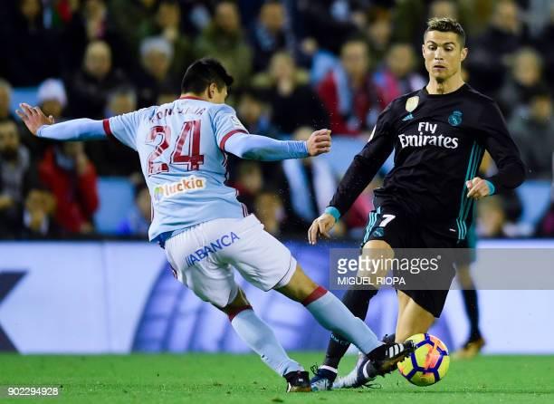 Celta Vigo's Argentinian defender Facundo Roncaglia challenges Real Madrid's Portuguese forward Cristiano Ronaldo during the Spanish league football...