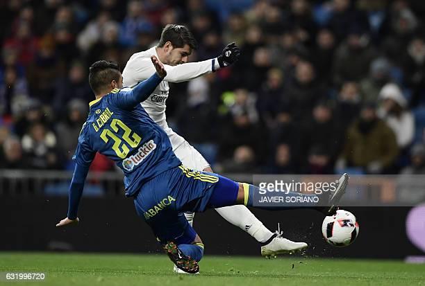 Celta Vigo's Argentinian defender Gustavo Cabral vies with Real Madrid's forward Alvaro Morata during the Spanish Copa del Rey quarterfinal first leg...