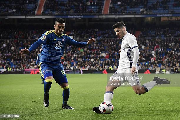 Celta Vigo's Argentinian defender Gustavo Cabral vies with Real Madrid's midfielder Marco Asensio during the Spanish Copa del Rey quarterfinal first...