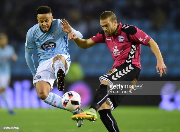 Celta Vigo's Belgian forward Theo Bongonda vies with Alaves' defender Victor Laguardia during the Spanish Copa del Rey semi final first leg football...