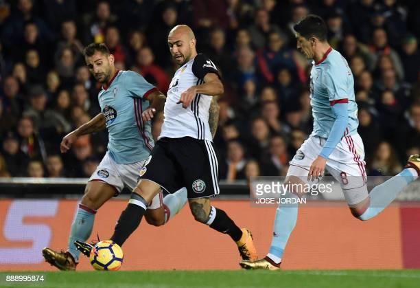 Celta Vigo's Chilean midfielder Pablo Hernandez and Celta Vigo's defender Jonny Castro vies with Valencia's Italian forward Simone Zaza during the...