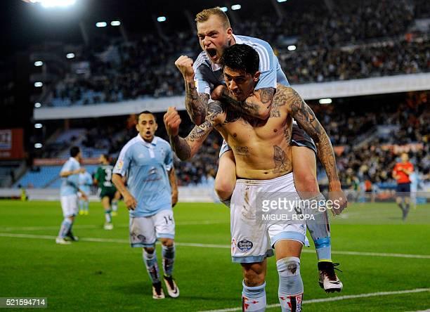 TOPSHOT Celta Vigo's Chilean midfielder Pablo Hernandez celebrates with teammate Swedish forward John Guidetti after scoring a goal during the...