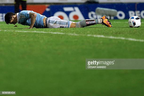 Celta Vigo's Chilean midfielder Pablo Hernandez lies on the field after missing a goal during the Spanish Copa del Rey semifinal second leg football...
