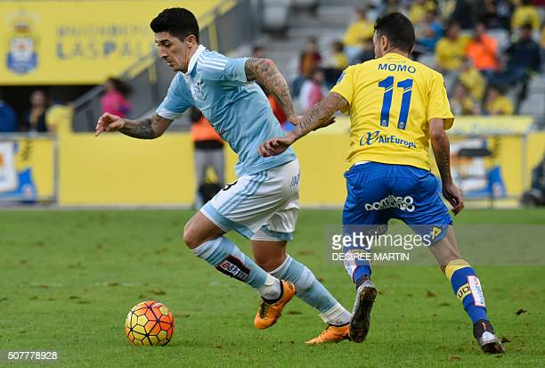 Celta Vigo's Chilean midfielder Pablo Hernandez vies with Las Palmas' midfielder Momo during the Spanish league football match UD Las Palmas vs Celta...