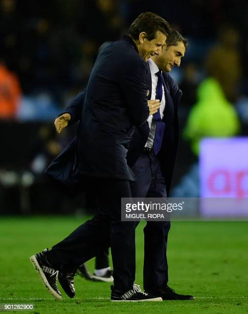 Celta Vigo's coach Juan Carlos Unzue cheers Barcelona's Spanish coach Ernesto Valverde at the end of the Spanish Copa del Rey football match RC Celta...