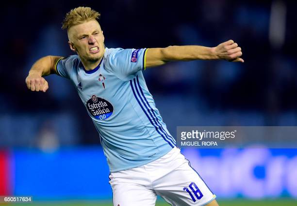 Celta Vigo's Danish midfielder Daniel Wass celebrates after scoring during the UEFA Europa League round of 16 first leg football match RC Celta de...