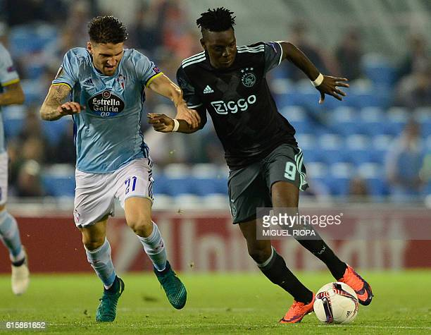 Celta Vigo's defender Carles Planas vies with Ajax's Burkinabe forward Bertrand Traore during the Europa League football match RC Celta de Vigo vs...