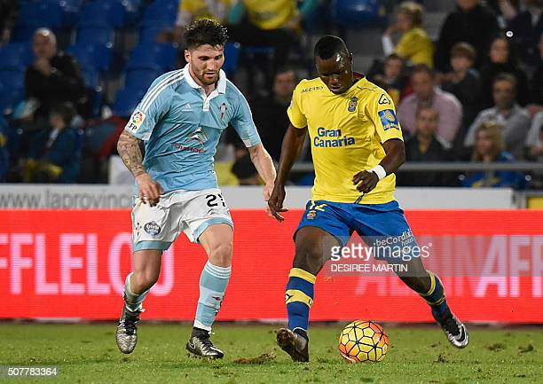 Celta Vigo's defender Carles Planas vies with Las Palmas' midfielder Wakaso Mubarak during the Spanish league football match UD Las Palmas vs RC...