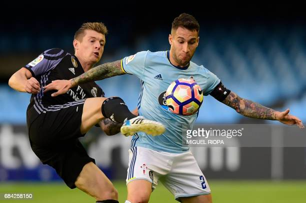 Celta Vigo's defender Hugo Mallo vies with Real Madrid's German midfielder Toni Kroos during the Spanish league football match RC Celta de Vigo vs...