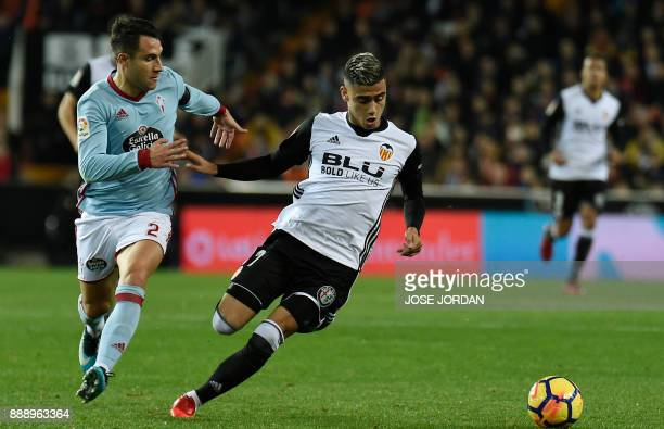 Celta Vigo's defender Hugo Mallo vies with Valencia's Belgian midfielder Andreas Pereira during the Spanish league football match between Valencia...