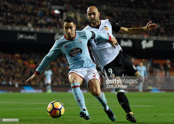 Celta Vigo's defender Hugo Mallo vies with Valencia's Italian forward Simone Zaza during the Spanish league football match between Valencia and Celta...