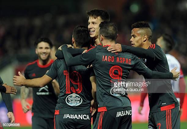 Celta Vigo's forward Iago Aspas celebrates with teammates after scoring a goal during the Spanish league football match Granada FC vs RC Celta de...