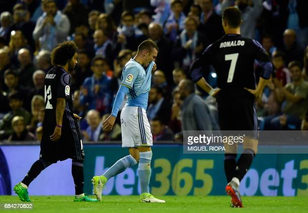 Celta Vigo's forward Iago Aspas leaves the pitch after being shown a red card during the Spanish league football match RC Celta de Vigo vs Real...
