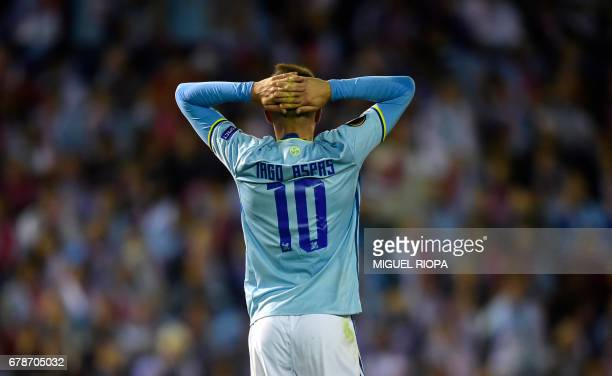 Celta Vigo's forward Iago Aspas reacts after missing a chance to score during their UEFA Europa League semi final first leg football match RC Celta...