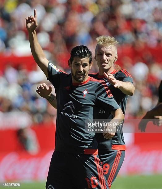 Celta Vigo's forward Nolito celebrates a goal with Celta Vigo's Danish defender Daniel Wass during the Spanish league football match Sevilla FC vs...