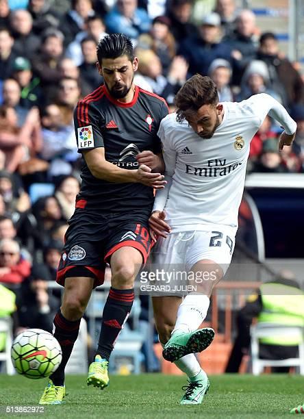 Celta Vigo's forward Nolito vies with Real Madrid's midfielder Mayoral during the Spanish league football match Real Madrid CF vs RC Celta de Vigo at...