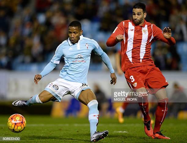 Celta Vigo's French forward Claudio Beauvue kicks to score a goal next to Sevilla's French defender Adil Rami during the Spanish league football...