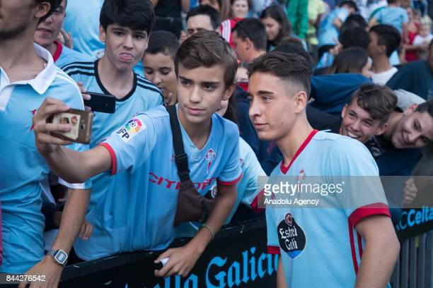 Celta Vigo's new transfer Turkish football player Emre Mor poses for a selfie with a fan during his media presentation event at Balaidos Stadium in...