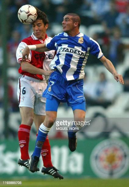 Celta Vigo's player argentinian Eduardo Berizzo heads for the ball with Deportivo Coruna's uruguayan Walter Pandiani , during the spanish first...