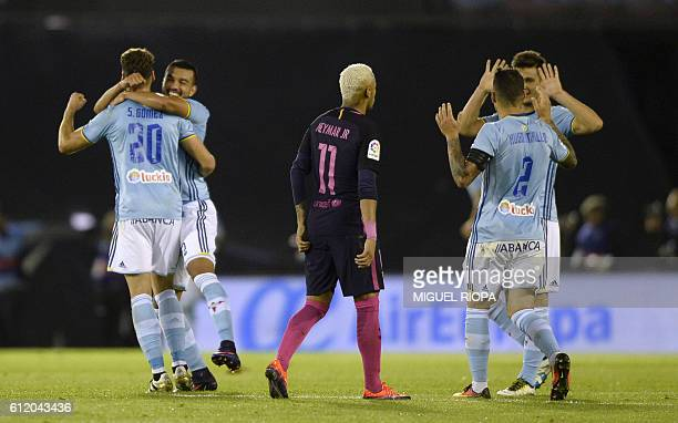 TOPSHOT Celta Vigo's players celebrate after scoring their second goal during the Spanish League football match RC Celta de Vigo vs FC Barcelona at...