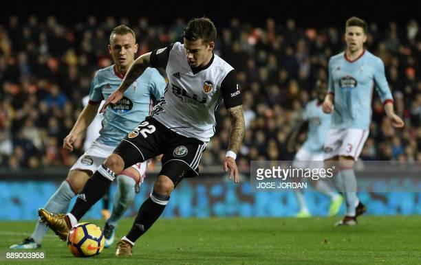 Celta Vigo's Slovak midfielder Stanislav Lobotka vies with Valencia's forward Santi Mina during the Spanish league football match between Valencia...