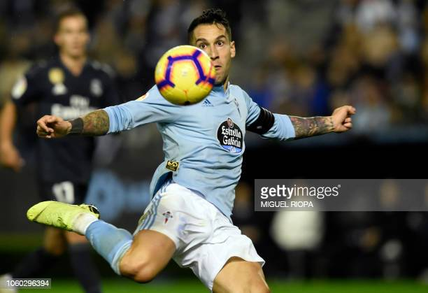 Celta Vigo's Spanish defender Hugo Mallo kicks the ball to score a goal during the Spanish league football match between RC Celta de Vigo and Real...