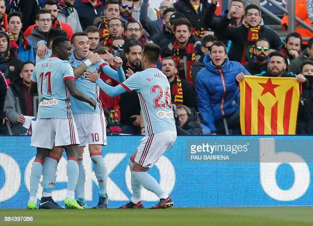 Celta Vigo's Spanish forward Iago Aspas celebrates after scoring the opening goal during the Spanish league football match FC Barcelona vs RC Celta...
