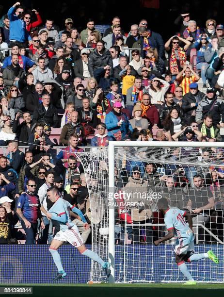 Celta Vigo's Spanish forward Iago Aspas celebrates after scoring the opening goal during the Spanish league football match FC Barcelona vs RC Celta...