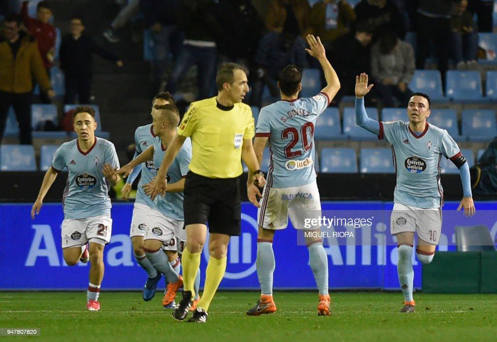 Celta Vigo's Spanish forward Iago Aspas (R) celebrates scoring a goal during the Spanish league football match between Celta de Vigo and FC Barcelona at the Balaidos stadium in Vigo, on April 17, 2018. /