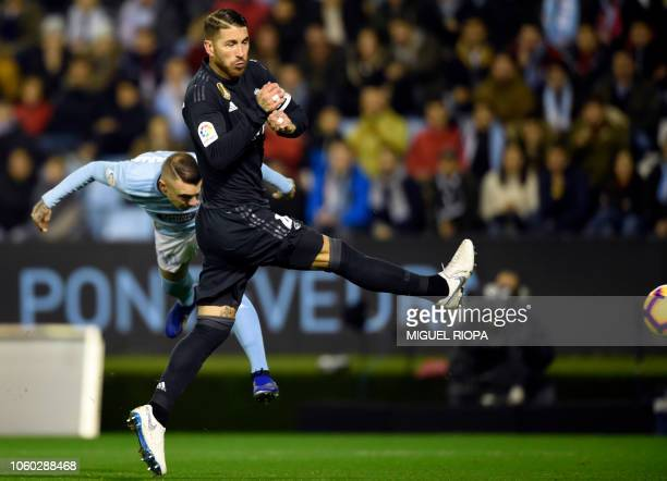Celta Vigo's Spanish forward Iago Aspas heads the ball beside Real Madrid's Spanish defender Sergio Ramos during the Spanish league football match...