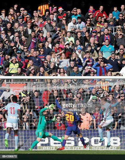 Celta Vigo's Spanish forward Iago Aspas scores the opening goal during the Spanish league football match FC Barcelona vs RC Celta de Vigo at the Camp...
