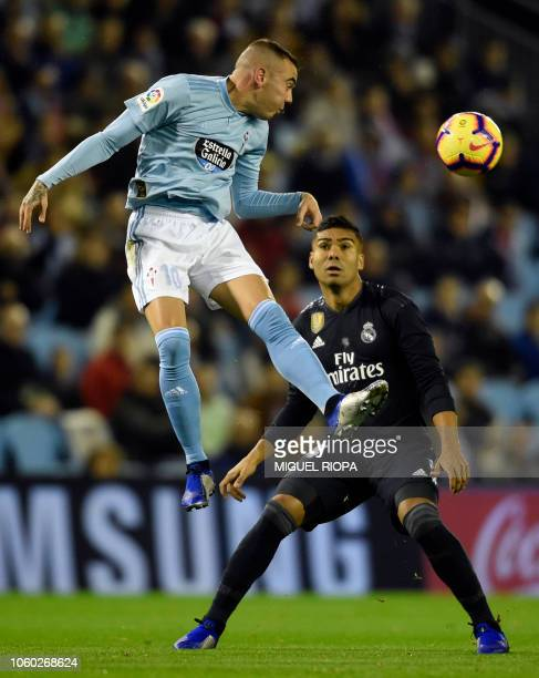 Celta Vigo's Spanish forward Iago Aspas vies with Real Madrid's Brazilian midfielder Casemiro during the Spanish league football match between Celta...