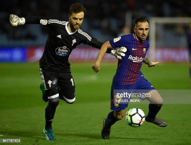 Celta Vigo's Spanish goalkeeper Sergio Alvarez vies with Barcelona's Spanish forward Paco Alcacer during the Spanish league football match between RC...