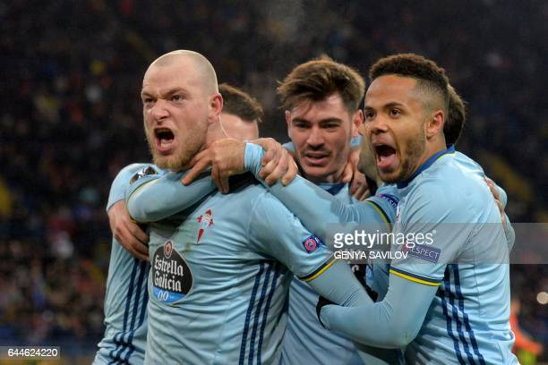 TOPSHOT Celta Vigo's Swedish forward John Guidetti and teammates celebrate after scoring during the UEFA Europa League round of 32 2nd leg football...