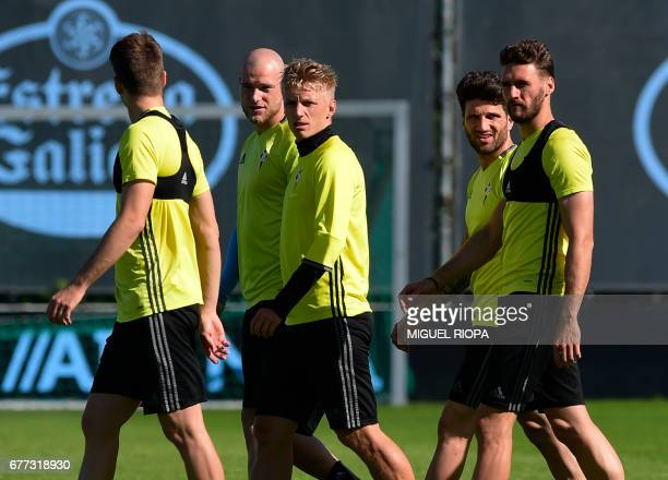 Celta Vigo's Swedish forward John Guidetti Danish midfielder Daniel Wass defender Carles Planas and defender Sergi Gomez arrive for a training...